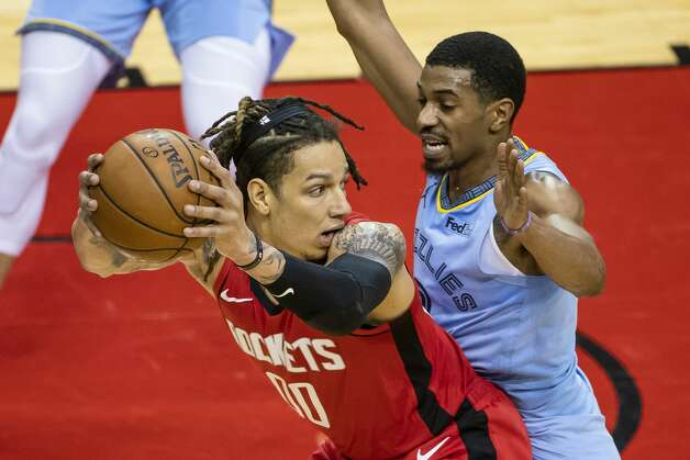 Houston Rockets forward D.J. Wilson (00) is defended by Memphis Grizzlies guard De'Anthony Melton (0) during the second quarter of an NBA game between the Houston Rockets and the Memphis Grizzlies on Monday, March 29, 2021, at Toyota Center in Houston. Photo: Mark Mulligan/Staff Photographer / © 2021 Mark Mulligan / Houston Chronicle