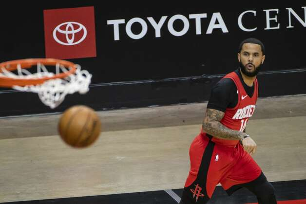 Houston Rockets guard D.J. Augustin (14) hits a three point shot during the first quarter of an NBA game between the Houston Rockets and the Memphis Grizzlies on Monday, March 29, 2021, at Toyota Center in Houston. Photo: Mark Mulligan/Staff Photographer / © 2021 Mark Mulligan / Houston Chronicle