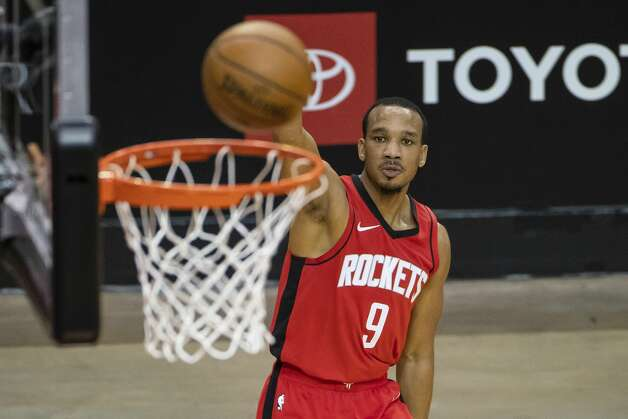 Houston Rockets guard Avery Bradley (9) shoots a three point shot during the second quarter of an NBA game between the Houston Rockets and the Memphis Grizzlies on Monday, March 29, 2021, at Toyota Center in Houston. Photo: Mark Mulligan/Staff Photographer / © 2021 Mark Mulligan / Houston Chronicle