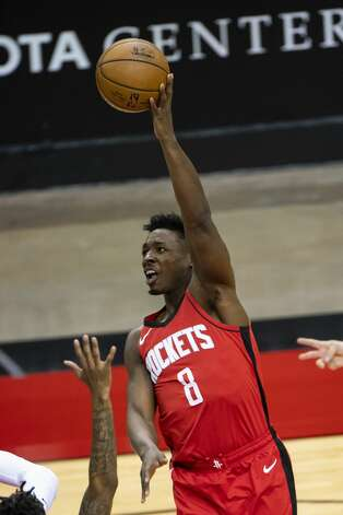 Houston Rockets forward Jae'Sean Tate (8) shoots during the first quarter of an NBA game between the Houston Rockets and the Memphis Grizzlies on Monday, March 29, 2021, at Toyota Center in Houston. Photo: Mark Mulligan/Staff Photographer / © 2021 Mark Mulligan / Houston Chronicle