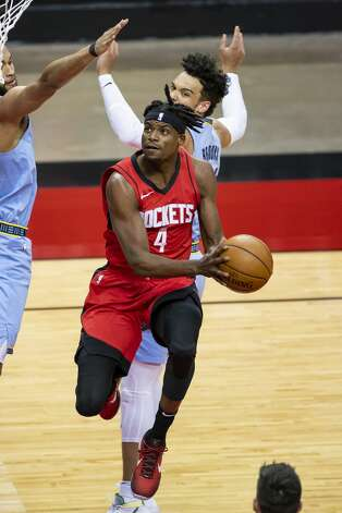 Houston Rockets forward Danuel House Jr. (4) drives during the first quarter of an NBA game between the Houston Rockets and the Memphis Grizzlies on Monday, March 29, 2021, at Toyota Center in Houston. Photo: Mark Mulligan/Staff Photographer / © 2021 Mark Mulligan / Houston Chronicle