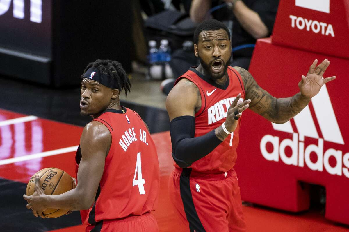 Houston Rockets guard John Wall (1) and Houston Rockets forward Danuel House Jr. (4) react to a call during the first quarter of an NBA game between the Houston Rockets and the Memphis Grizzlies on Monday, March 29, 2021, at Toyota Center in Houston.