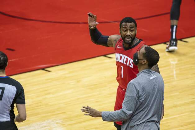 Houston Rockets guard John Wall (1) talks with Houston Rockets head coach Stephen Silas about a call during the first quarter of an NBA game between the Houston Rockets and the Memphis Grizzlies on Monday, March 29, 2021, at Toyota Center in Houston. Photo: Mark Mulligan/Staff Photographer / © 2021 Mark Mulligan / Houston Chronicle