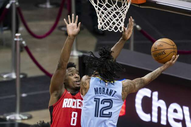 Houston Rockets forward Jae'Sean Tate (8) defends a shot by Memphis Grizzlies guard Ja Morant (12) during the first quarter of an NBA game between the Houston Rockets and the Memphis Grizzlies on Monday, March 29, 2021, at Toyota Center in Houston. Photo: Mark Mulligan/Staff Photographer / © 2021 Mark Mulligan / Houston Chronicle