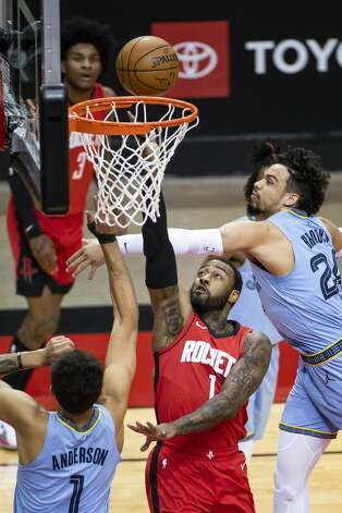 Houston Rockets guard John Wall (1) shoots around Memphis Grizzlies forward Dillon Brooks (24) during the first quarter of an NBA game between the Houston Rockets and the Memphis Grizzlies on Monday, March 29, 2021, at Toyota Center in Houston. Photo: Mark Mulligan/Staff Photographer / © 2021 Mark Mulligan / Houston Chronicle
