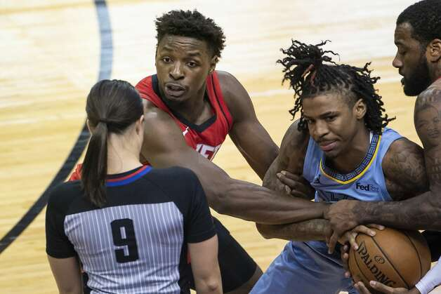 Houston Rockets forward Jae'Sean Tate (8) looks at referee Natalie Sago (9) asking for a jump ball with Memphis Grizzlies guard Ja Morant (12) during the fourth quarter of an NBA game between the Houston Rockets and the Memphis Grizzlies on Monday, March 29, 2021, at Toyota Center in Houston. Photo: Mark Mulligan/Staff Photographer / © 2021 Mark Mulligan / Houston Chronicle