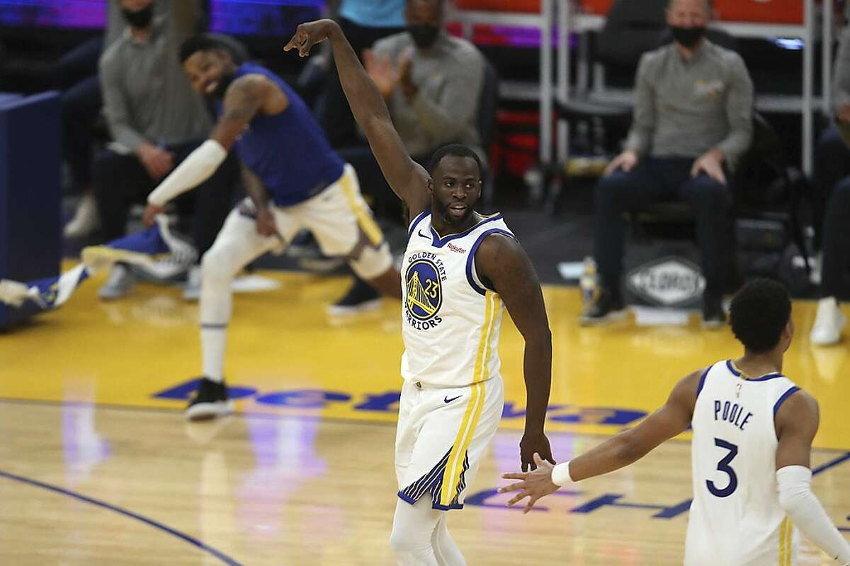 Golden State Warriors forward Draymond Green, center, celebrates after a three-point basket against the Chicago Bulls during the first half of an NBA basketball game in San Francisco, Monday, March 29, 2021. (AP Photo/Jed Jacobsohn)