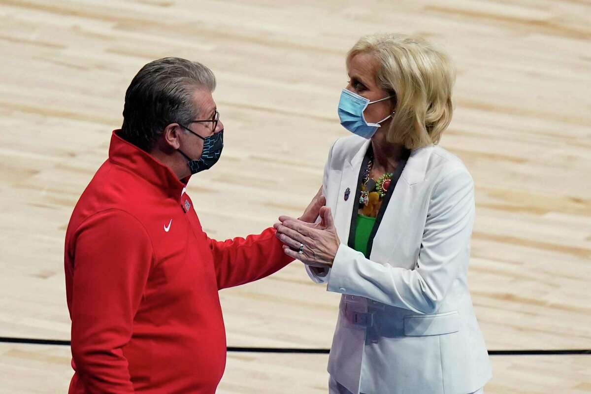 UConn head coach Geno Auriemma, left, and Baylor head coach Kim Mulkey, right, a college basketball game in the Elite Eight round of the women's NCAA tournament at the Alamodome in San Antonio, Monday, March 29, 2021. (AP Photo/Eric Gay)