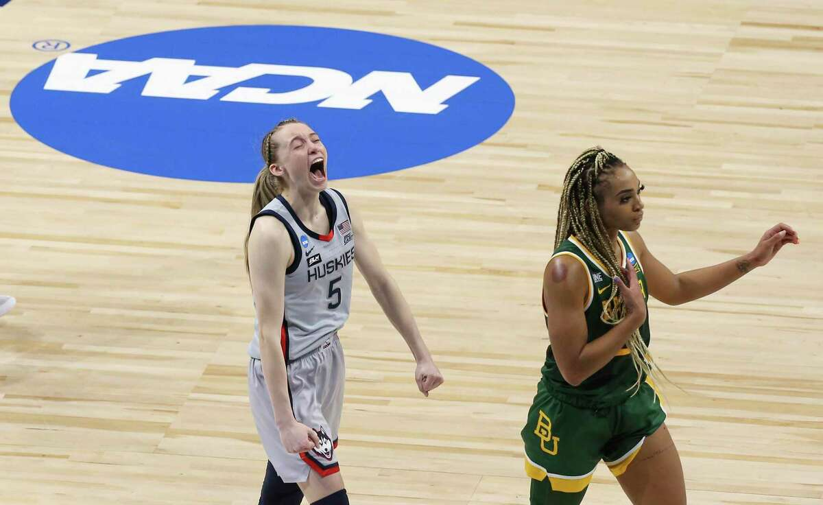 University of Connecticut's Paige Bueckers (05) reacts to the Huskies victory as Baylor's DiJonai Carrington (21) walks away at the end of their regional championship game of the 2021 NCAA Women's Basketball tournament at the Alamodome on Monday, Mar. 29, 2021. UConn outlasts Baylor, 69-67, to move onto the Final Four round.