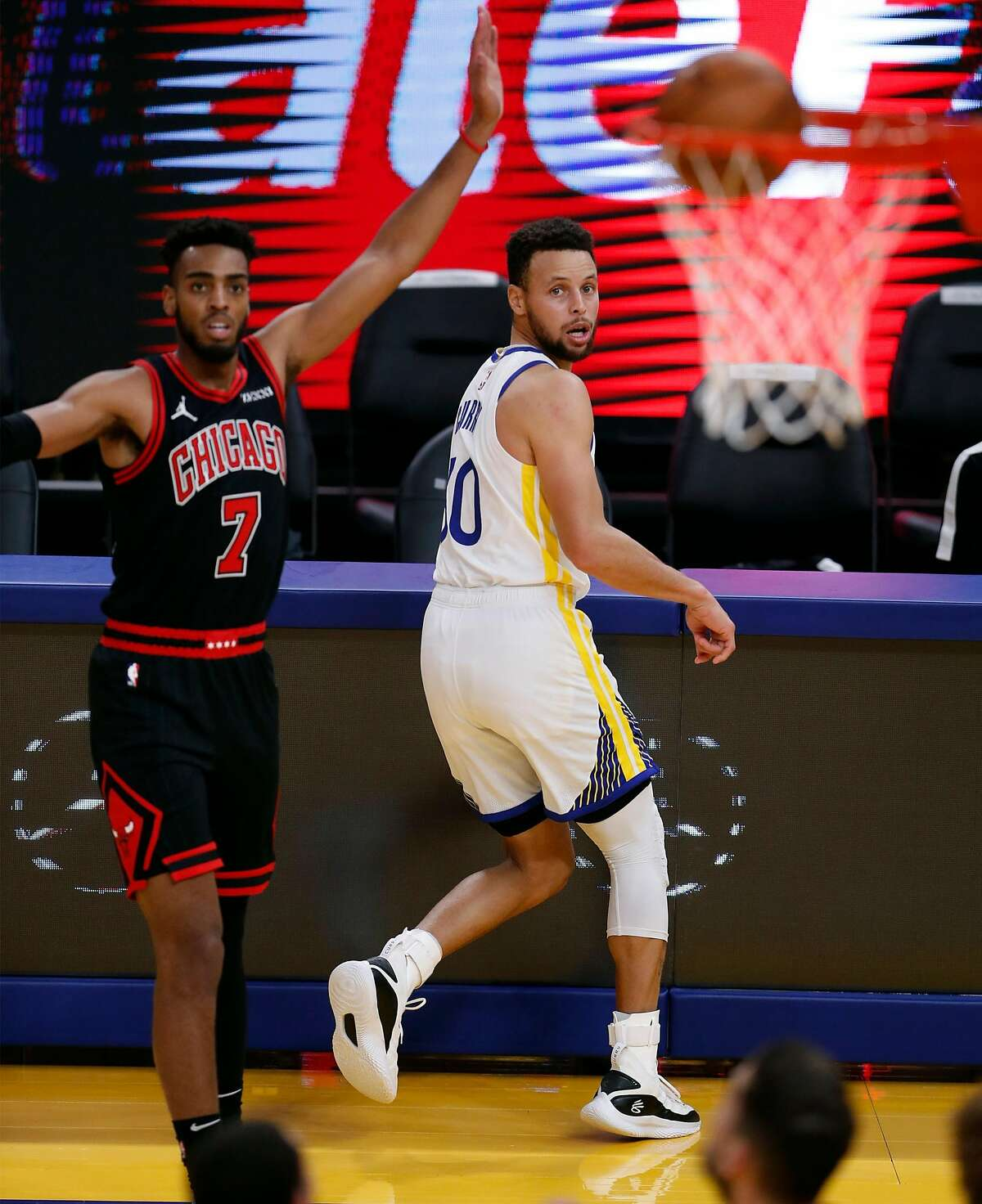 Curry and Chicago's Troy Brown Jr. watch the Warrior's 3-pointer go in at Chase Center in San Francisco.during 2nd quarter of NBA game at Chase Center in San Francisco, Calif., on Monday, March 29, 2021,