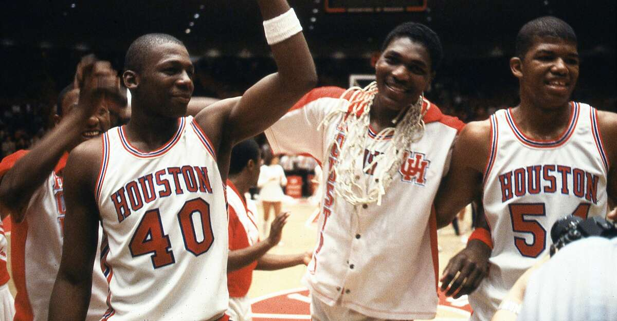 02/29/1984 - Houston Cougars Rickie Winslow (40), Akeem Olajuwon and Greg Anderson (54) celebrate their second consecutive Southwest Conference title after defeating the Baylor Bears, 80-65.