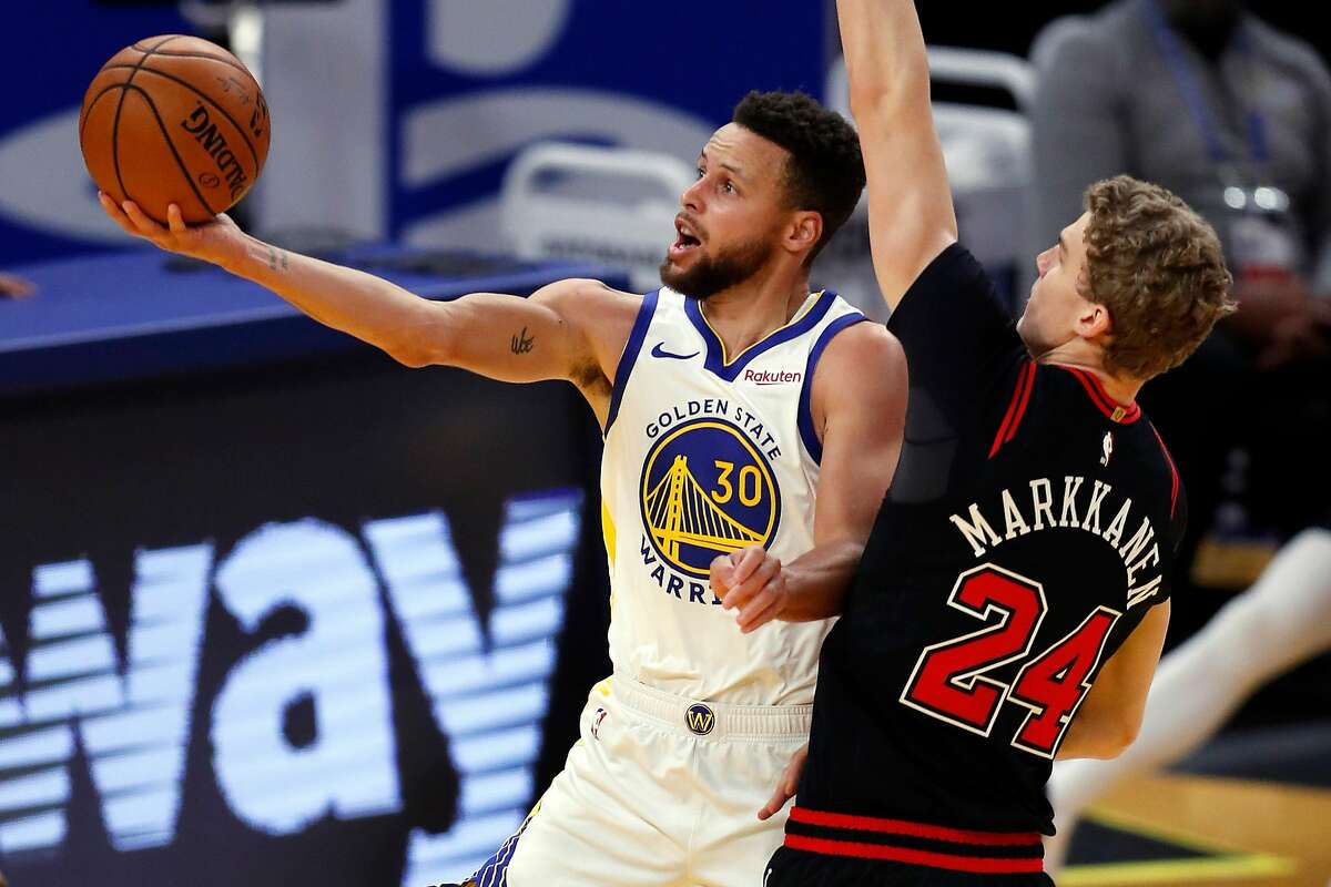 Golden State Warriors' Stephen Curry scores against Chicago Bulls' Lauri Markkanen during 3rd quarter of NBA game at Chase Center in San Francisco, Calif., on Monday, March 29, 2021,