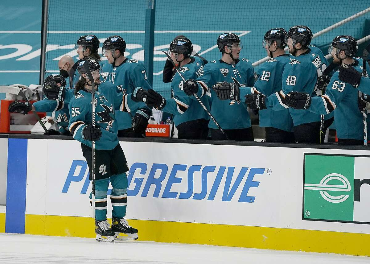 Sharks defenseman Erik Karlsson is congratulated by the bench after scoring in the second period against Minnesota.