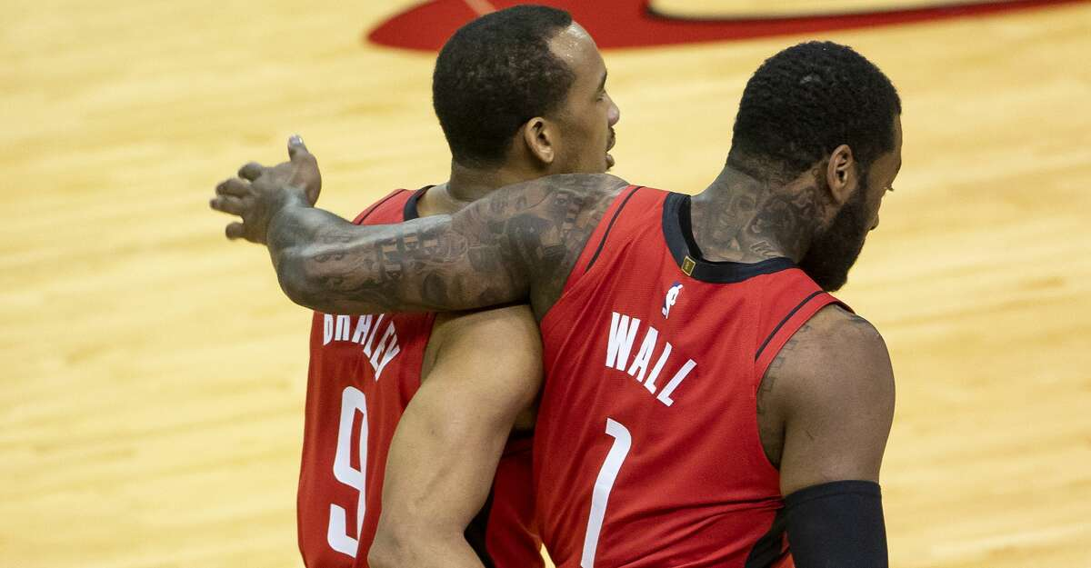Houston Rockets guard John Wall (1) and Houston Rockets guard Avery Bradley (9) walk back to the sideline during the second quarter of an NBA game between the Houston Rockets and the Memphis Grizzlies on Monday, March 29, 2021, at Toyota Center in Houston.