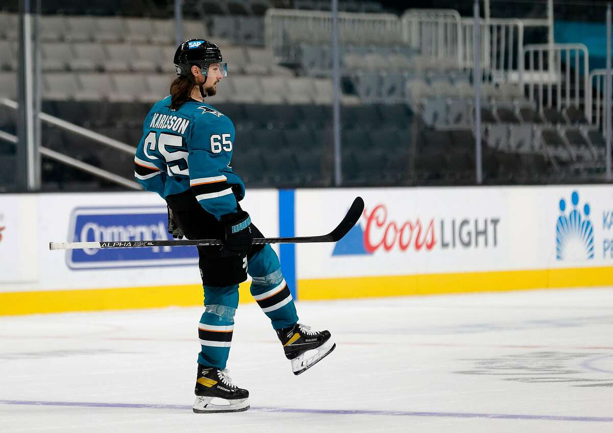 SAN JOSE, CALIFORNIA - MARCH 29: Erik Karlsson #65 of the San Jose Sharks celebrates after he scored the winning goal against the Minnesota Wild in a shootout at SAP Center on March 29, 2021 in San Jose, California. (Photo by Ezra Shaw/Getty Images)
