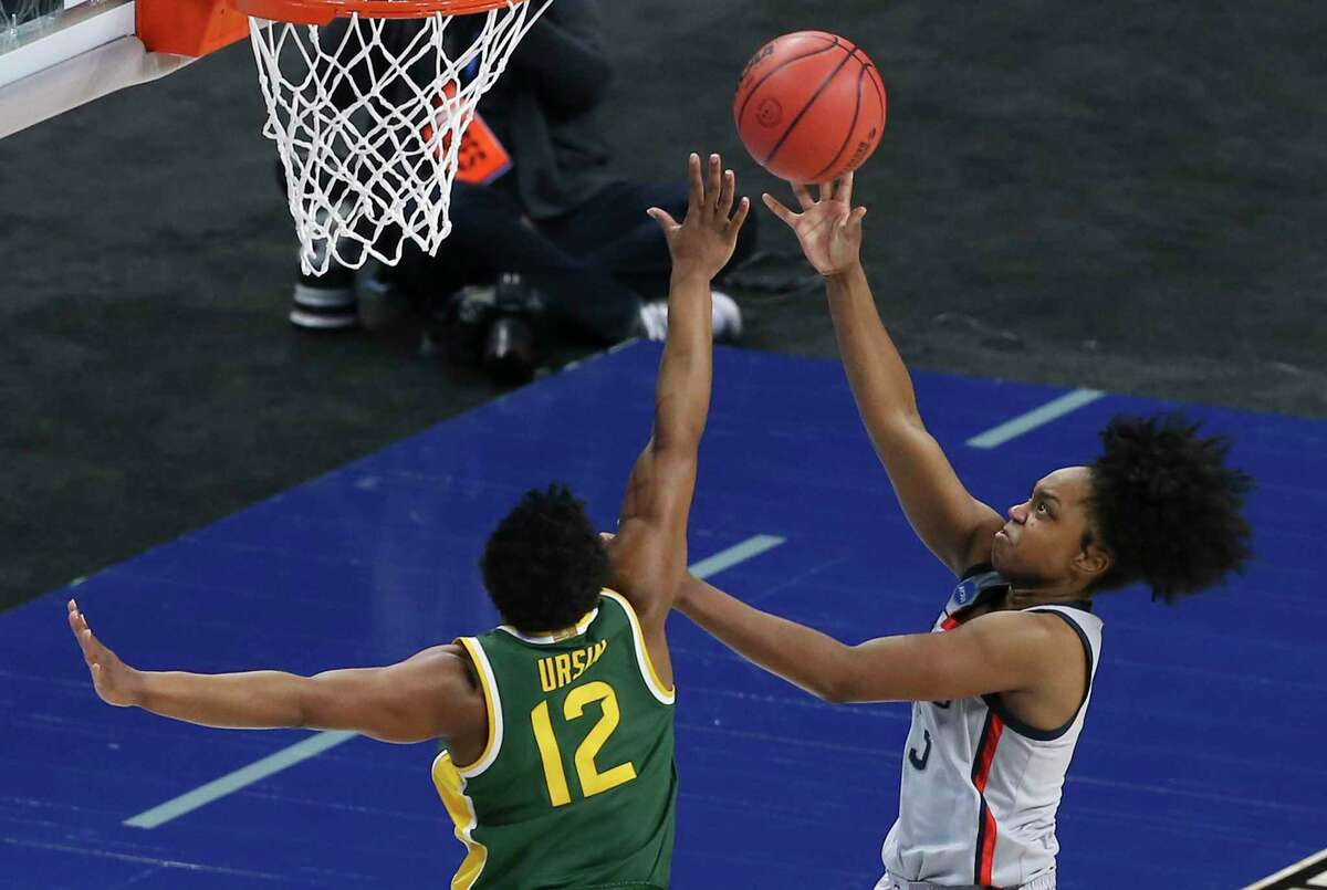 Baylor's Moon Ursin (12) attempts to defend against University of Connecticut's Aaliyah Edwards (03) during their Elite Eight regional championship game of the 2021 NCAA Women's Basketball tournament at the Alamodome on Monday, Mar. 29, 2021. UConn outlasts Baylor, 69-67, to move onto the Final Four round.