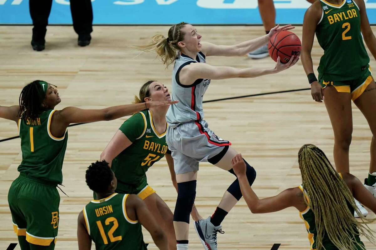 UConn guard Paige Bueckers , center, drives to the basket against Baylor during the first half of a college basketball game in the Elite Eight round of the women's NCAA tournament at the Alamodome in San Antonio, Monday, March 29, 2021. (AP Photo/Eric Gay)