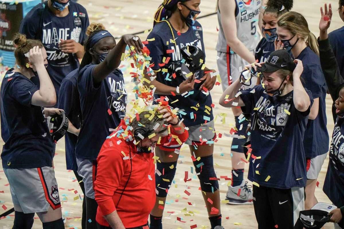 UConn head coach Geno Auriemma is dunked with confetti after an NCAA college basketball game against Baylor in the Elite Eight round of the Women's NCAA tournament Monday, March 29, 2021, at the Alamodome in San Antonio. UConn won 69-67 to advance to the Final Four. (AP Photo/Morry Gash)