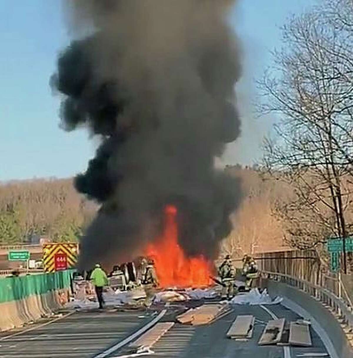 Crews on scene for an overturned tractor-trailer on fire on the Rocheambeau Bridge, which is under construction, on Interstate 84 on the Newtown-Southbury line on Tuesday, March 30, 2021.