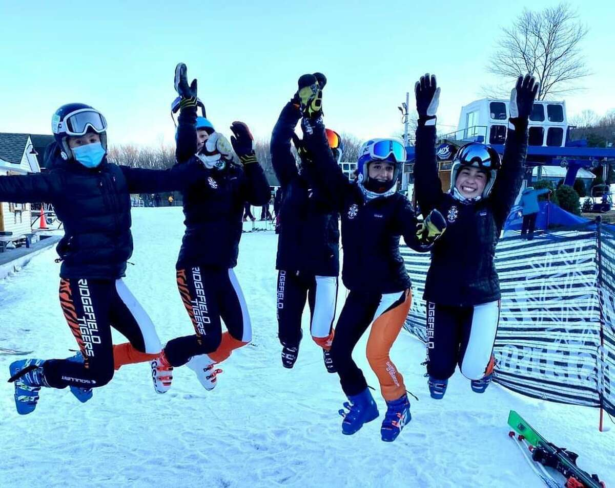 Members of the Ridgefield High School girls' ski team jumped for joy after clinching the state championships.