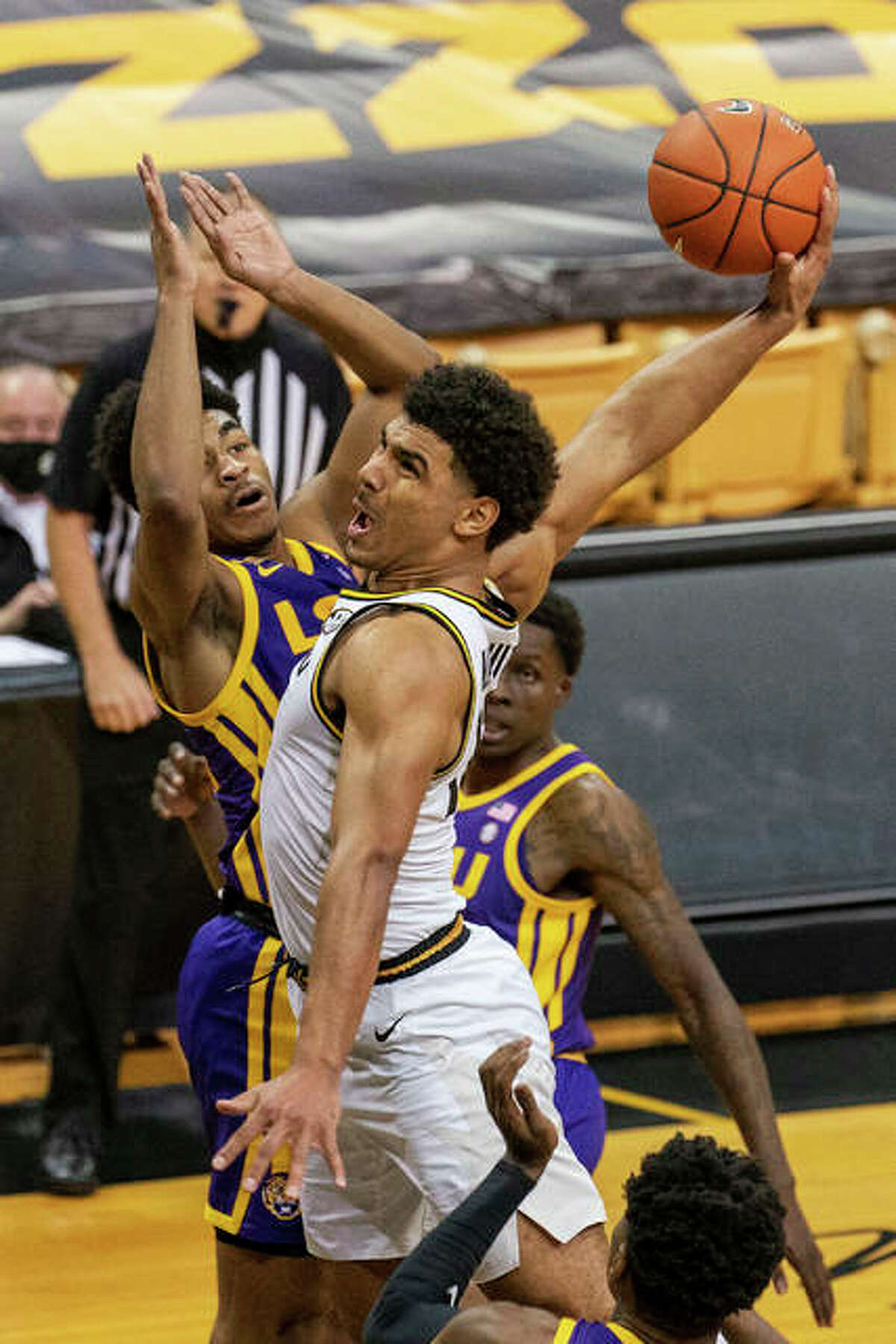 Missouri's Mark Smith, right, shoots over LSU's Cameron Thomas, left, March 6, 2021, in Columbia, Mo.