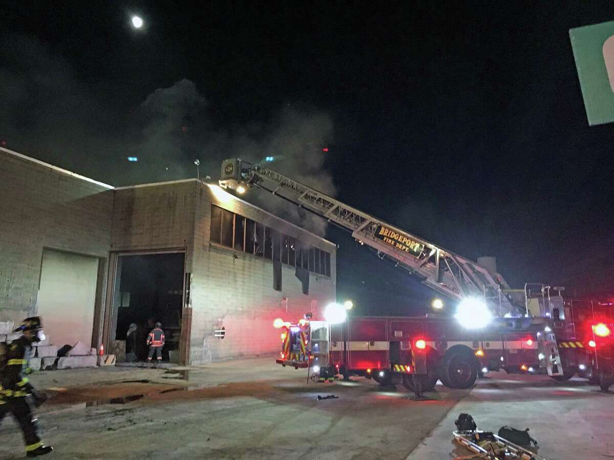 Fire units operating at the scene of a fire at 555 Wordin Ave. - Enviro Express, a large commercial garage - in Bridgeport, Conn., shortly before 5 a.m. on Tuesday, March 30, 2021.