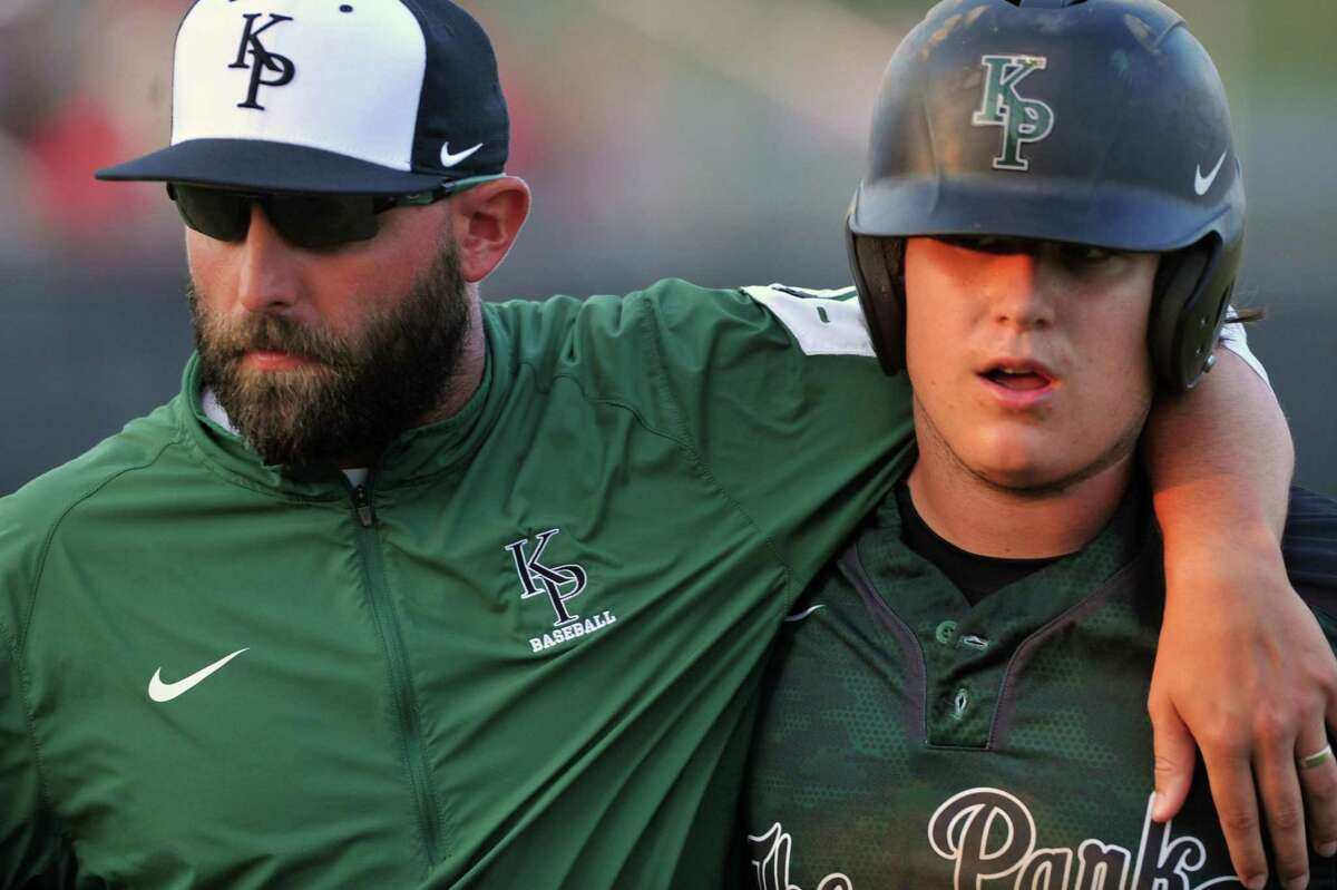 Rosenberg Terry and Kingwood Park baseball teams met at Cy Woods High School for a playoff game, 5-13-2016. Kingwood Park won the game, 4-0. Left, Kingwood Park varsity baseball coach Bruce Cox greets Steven Hodgson after he scored a run.