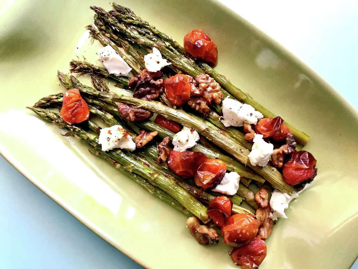 Roasted Asparagus & Tomatoes recipe brings classic flavors together in one easy dish.