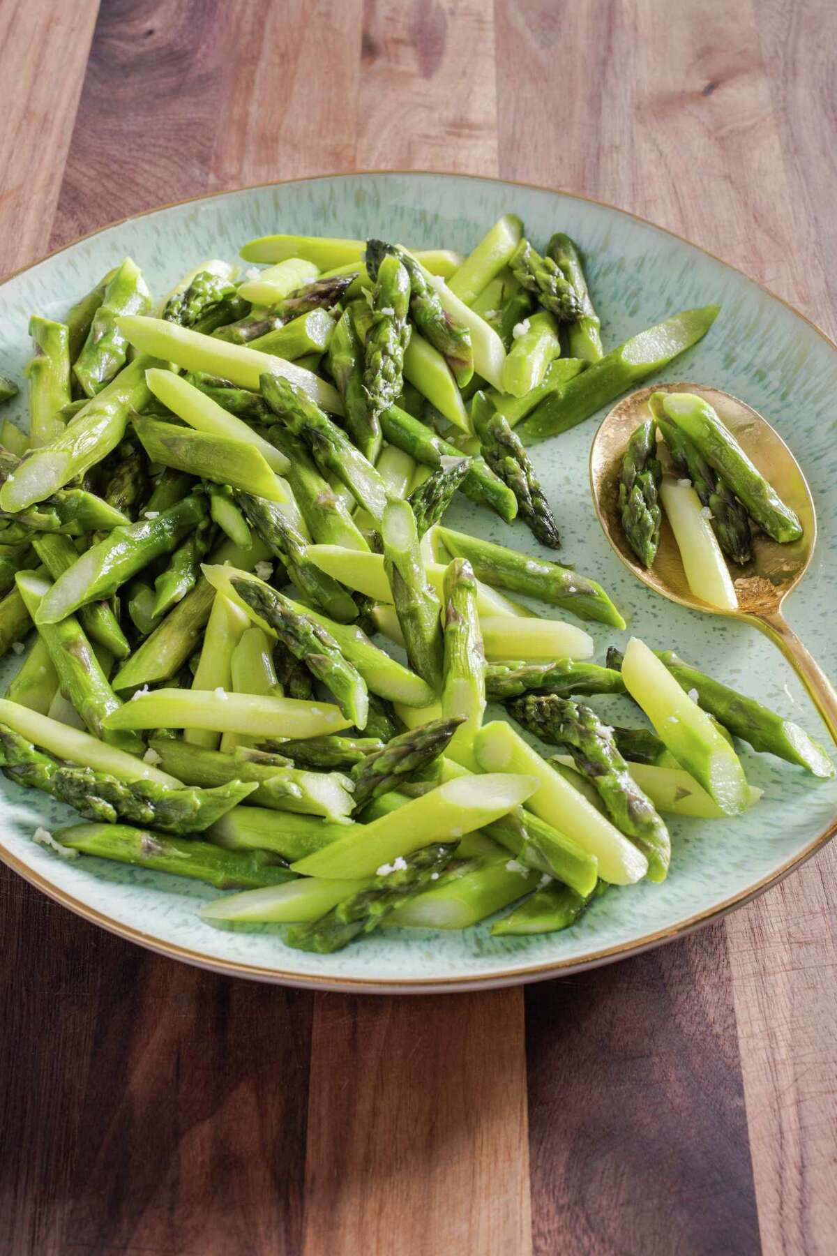 Simple pan-cooked asparagus is flavored with only garlic, butter and salt.