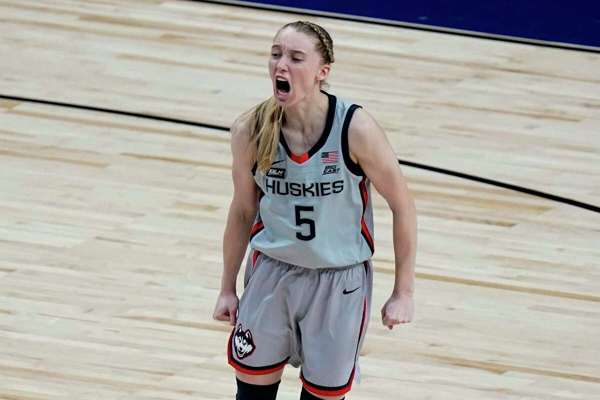 UConn guard Paige Bueckers (5) celebrates a score against Baylor during the second half of a college basketball game in the Elite Eight round of the women's NCAA tournament at the Alamodome in San Antonio, Monday, March 29, 2021.