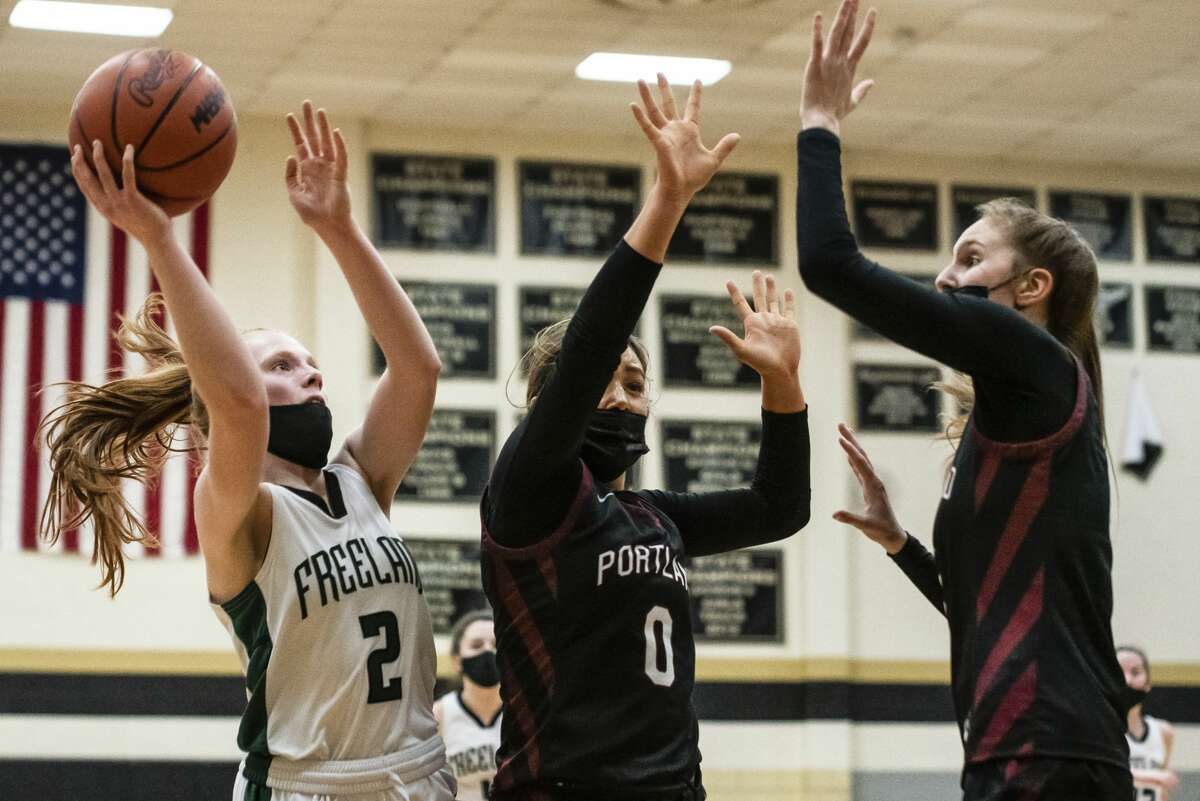 Freeland's Whitney Farrell shoots the ball and is fouled during their regional semifinal against Portland Monday, March 29, 2021 at Corunna High School. (Isaac Ritchey/for the Daily News)