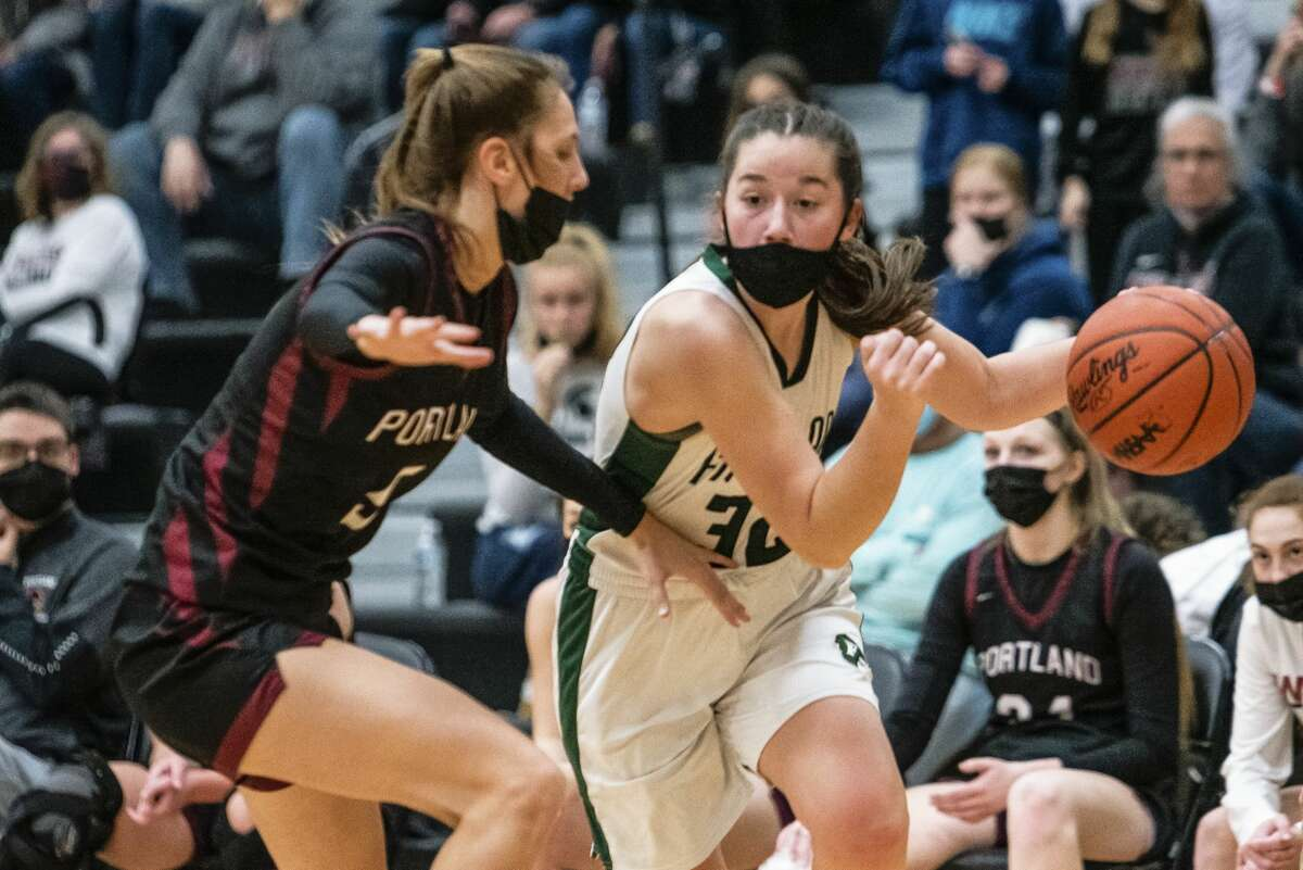 Freeland's Sophia Argyle drives the ball during their regional semifinal against Portland Monday, March 29, 2021 at Corunna High School. (Isaac Ritchey/for the Daily News)