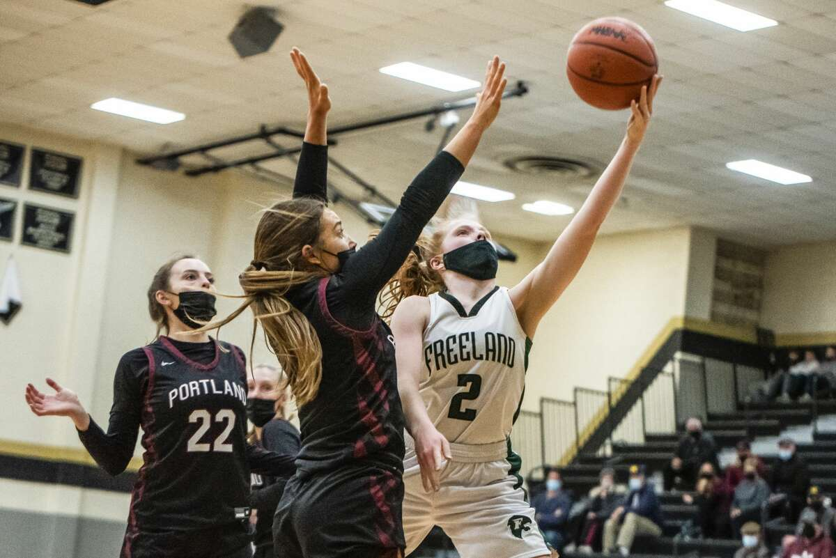 Freeland's Whitney Farrell shoots the ball during their regional semifinal against Portland Monday, March 29, 2021 at Corunna High School. (Isaac Ritchey/for the Daily News)