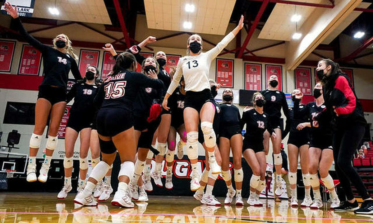 SIUE senior libero Jordyn Klein (13) and her Cougars teammates react Monday night after the scoreboard video at First Community Arena showed a UT Martin victory that clinched SIUE's berth to the OVC Tourney after the Cougars' swept Eastern Illinois.