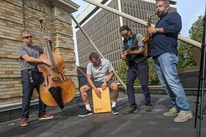 The Amico Baraday Quartet performs on the roof outside the Palace Theatre in Albany. The jazz group's drummer, Vinnie Amico, holds the same position in jam band moe., and was instrumental in getting that latter band to perform a fundraising virtual concert at the Palace.