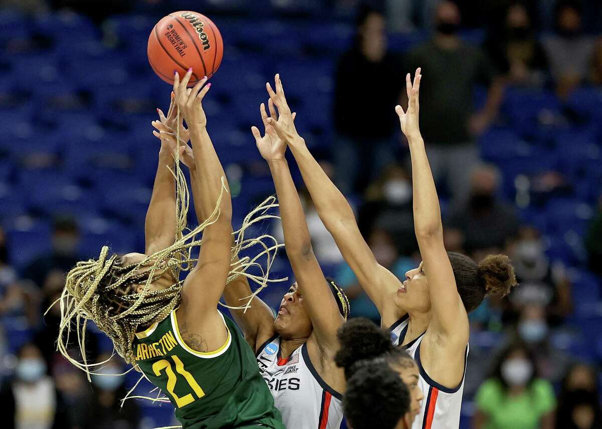 SAN ANTONIO, TEXAS - MARCH 29: DiJonai Carrington #21 of the Baylor Lady Bears tries to take a shot as Aaliyah Edwards #3 and Olivia Nelson-Ododa #20 of the UConn Huskies defend in the final minutes of the game during the Elite Eight round of the NCAA Women's Basketball Tournament at the Alamodome on March 29, 2021 in San Antonio, Texas.The UConn Huskies defeated the Baylor Lady Bears 69-67 to advance to the Final Four. (Photo by Elsa/Getty Images)