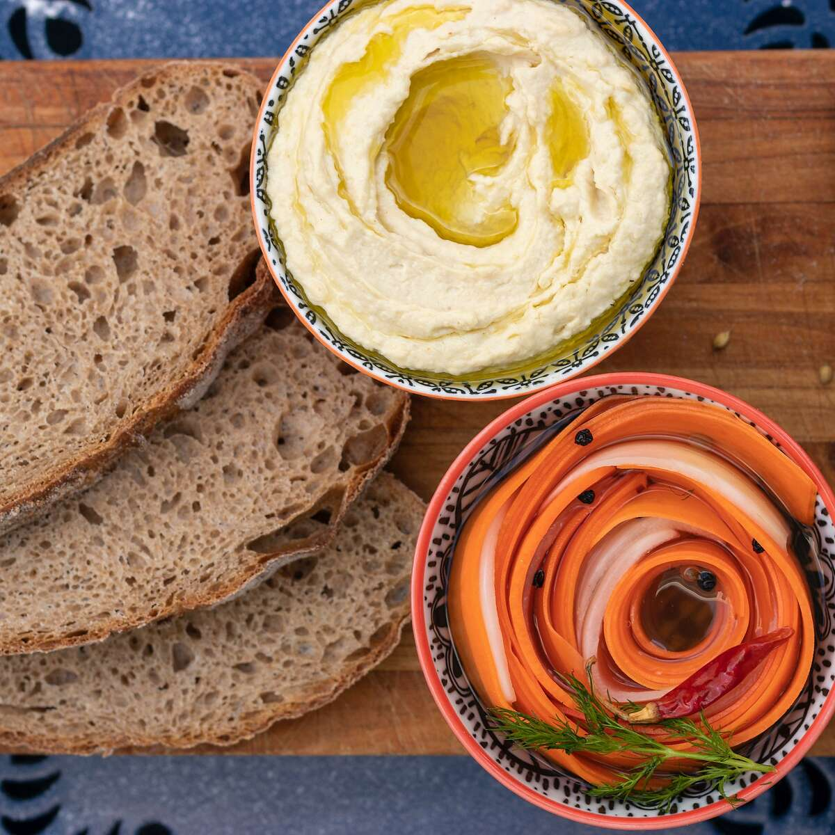 A set of bread, carrot pickles and hummus from pop-up Bread Spread Pickle. The pop-up has now closed.