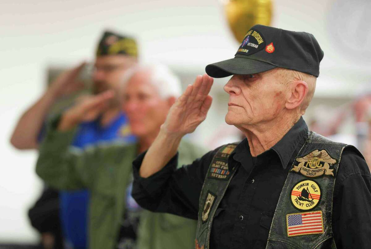 Vietnam veteran Hal Shirley salutes as the national anthem is played during a celebration of National Vietnam War Veterans Day at the Veterans of Foreign Wars Post 4709 this week in Conroe.