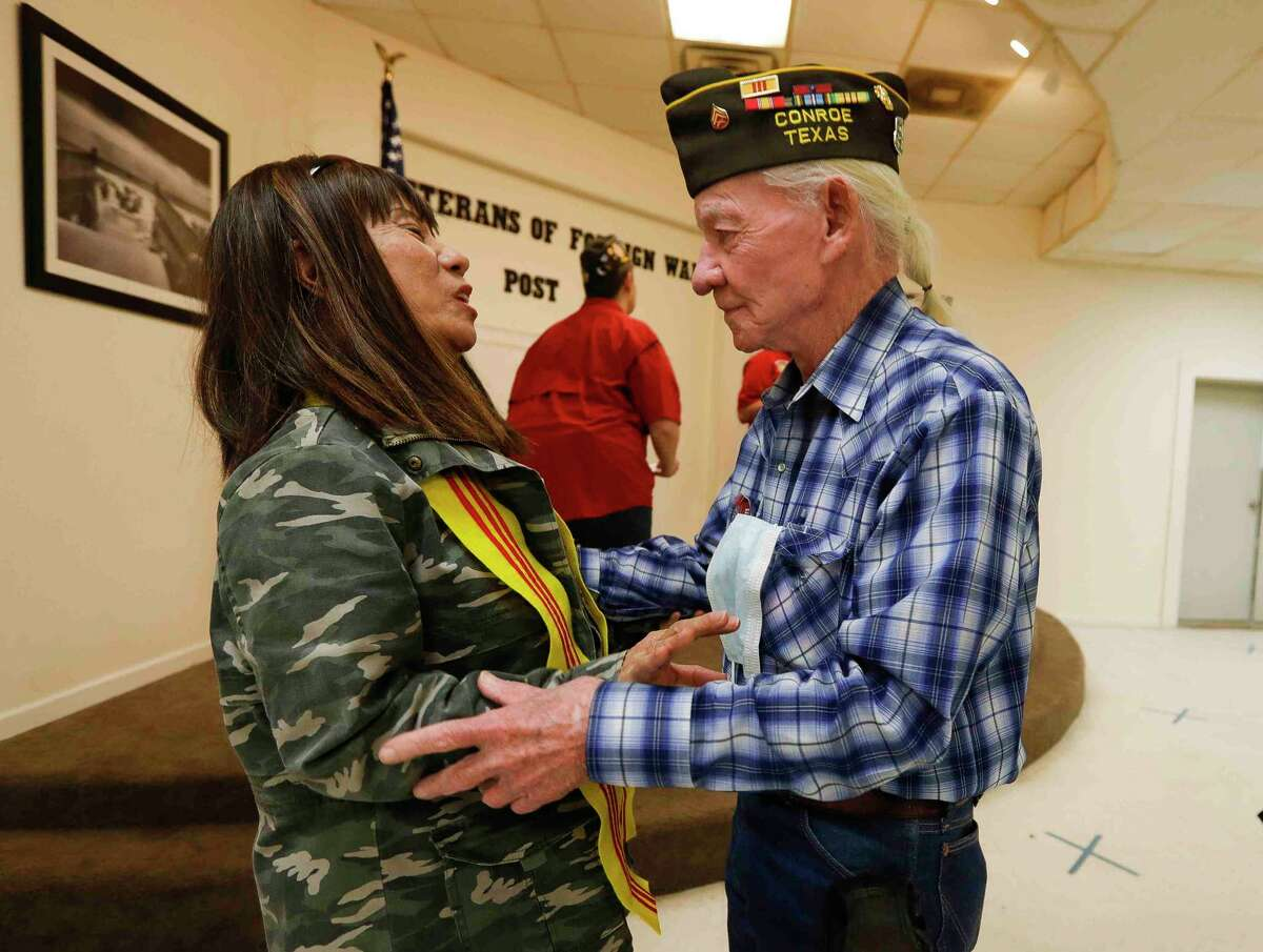 Vietnam veteran Gary Burgess, right, shares a moment with Christine Helmafter she spoke about her and her husband's experience in the war during the Vietnam War, during a celebration of National Vietnam War Veterans Day at the Veterans of Foreign Wars Post 4709, Tuesday, March, 29, 2021, in Conroe. Her husband is missing in action after serving in the South Vietnamese Army. The event recognized veterans who served in the US military during the Vietnam War.