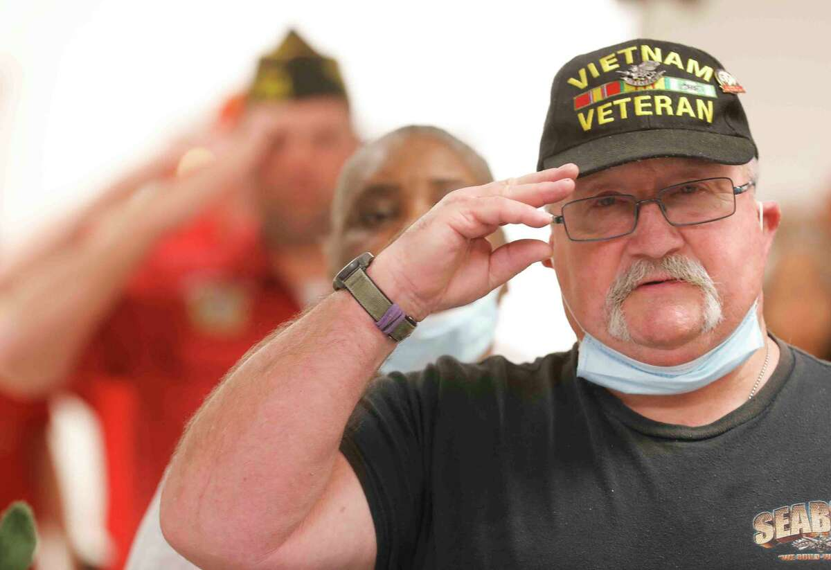 Vietnam veteran Michael Gerrer salutes as the national anthem is played during a celebration of National Vietnam War Veterans Day at the Veterans of Foreign Wars Post 4709, Tuesday, March, 29, 2021, in Conroe. The event recognized veterans who served in the US military during the Vietnam War.