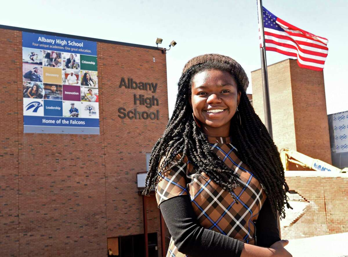 Albany High School valedictorian Onovu Otitigbe-Dangerfield stands outside the high school on Tuesday, March 30, 2021 in Albany, N.Y. Dangerfield is the school's first black valedictorian. (Lori Van Buren/Times Union)