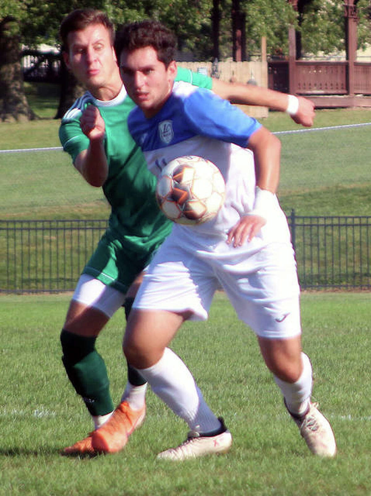 Tony Bodul of LCCC, front, jockeys with a John Woods College player for possession of the ball last season at LCCC.