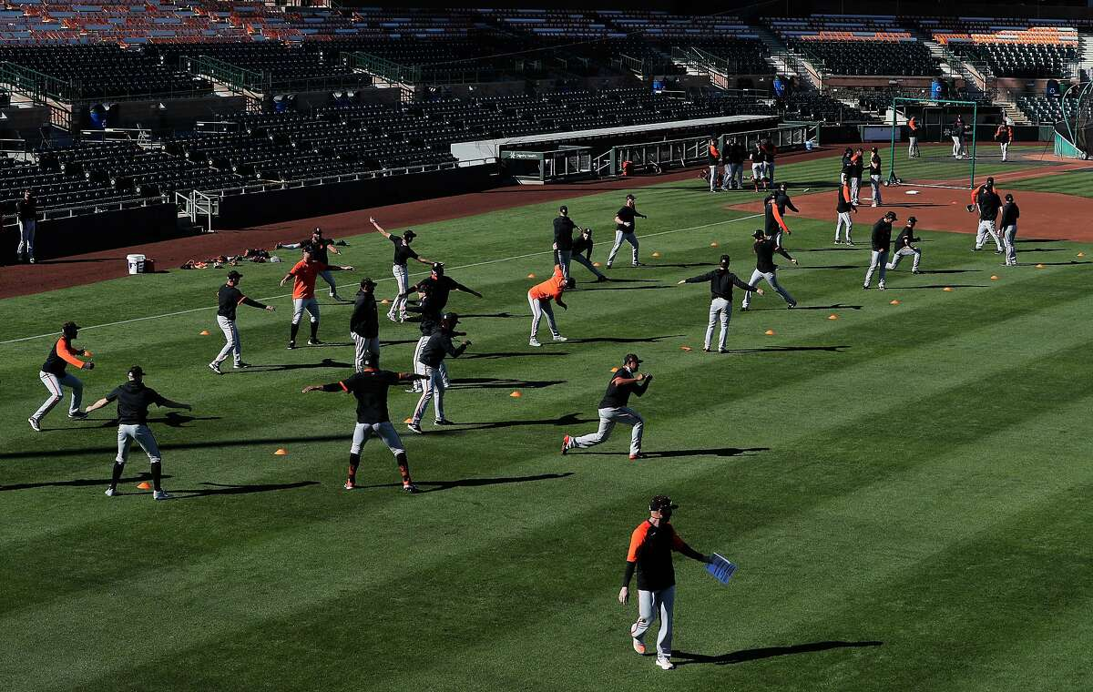Players stretching as the San Francisco Giants worked out at Scottsdale Stadium in Scottsdale, Ariz., on Monday, March 1, 2021.