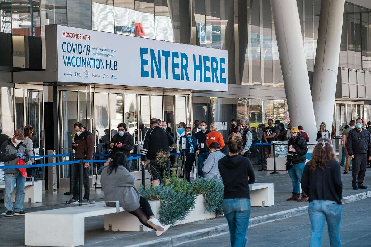 Bay Area residents line up for vaccinations at Moscone Center in February.