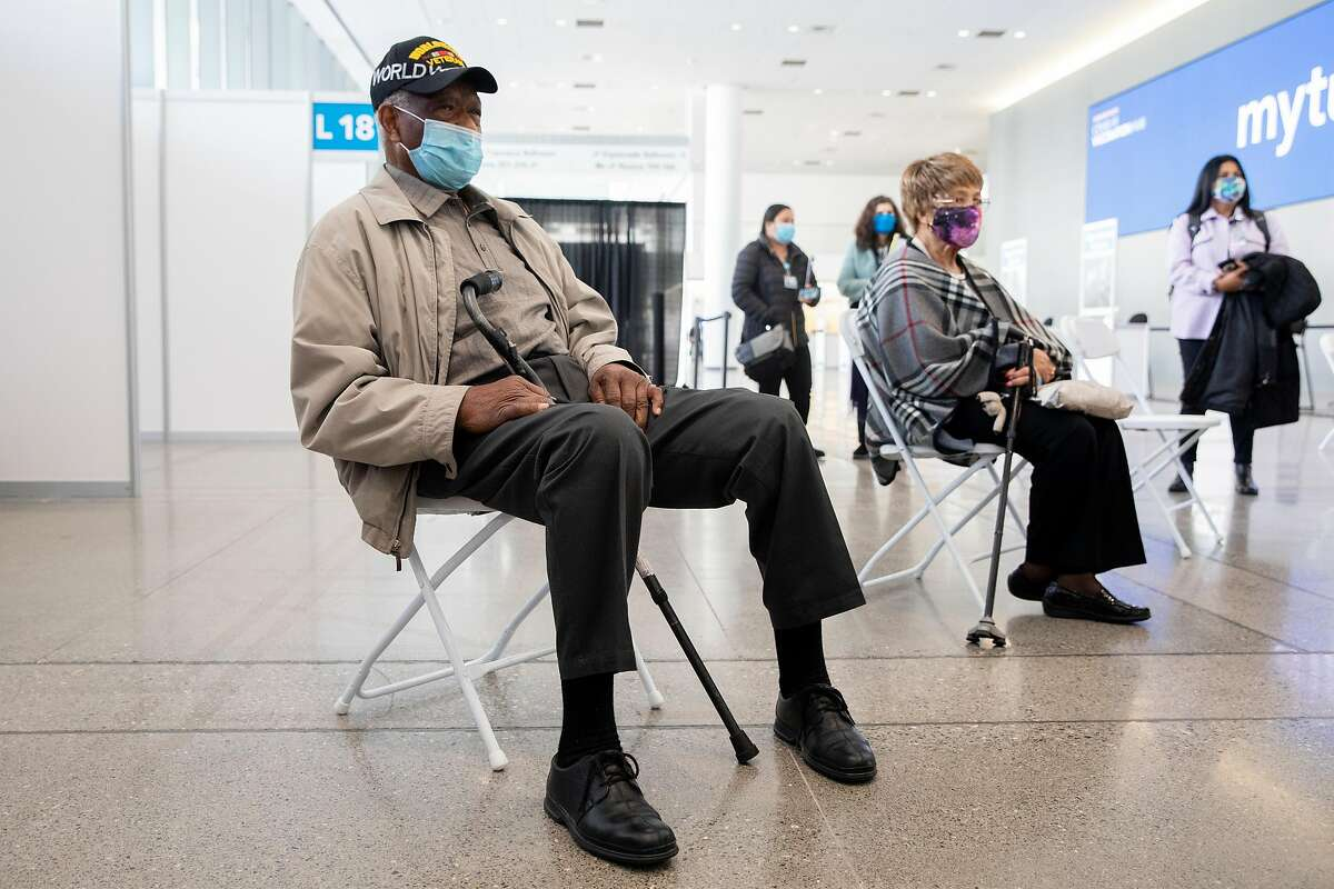 Ezekiel Logan, a 96-year-old World War II veteran, waits to receive his first dose of the Pfizer COVID-19 vaccine ahead of the grand opening of a mass COVID-19 vaccination site at Moscone South in San Francisco, Calif. Thursday, February 4, 2021.