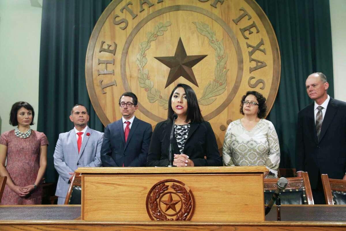MALDEF Legislative Attorney Fatima Menendez speaks as members of the Mexican American Legislative Caucus watch on September 13, 2017.