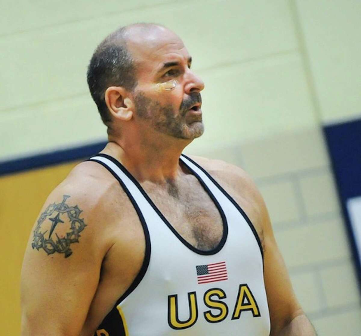 Ridgefield resident Mark Dollins, 60, will return to the USA Wrestling Folkstyle Championships this weekend in the hopes of claiming his third national title.