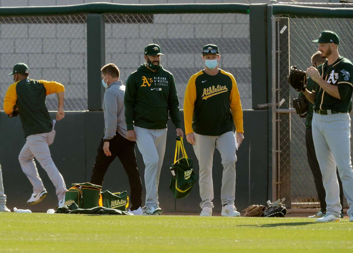 The A's hope Mike Fiers, center holding bag, will make his 2021 debut sometime in April after he dealt with hip inflammation throughout most of the spring camp.