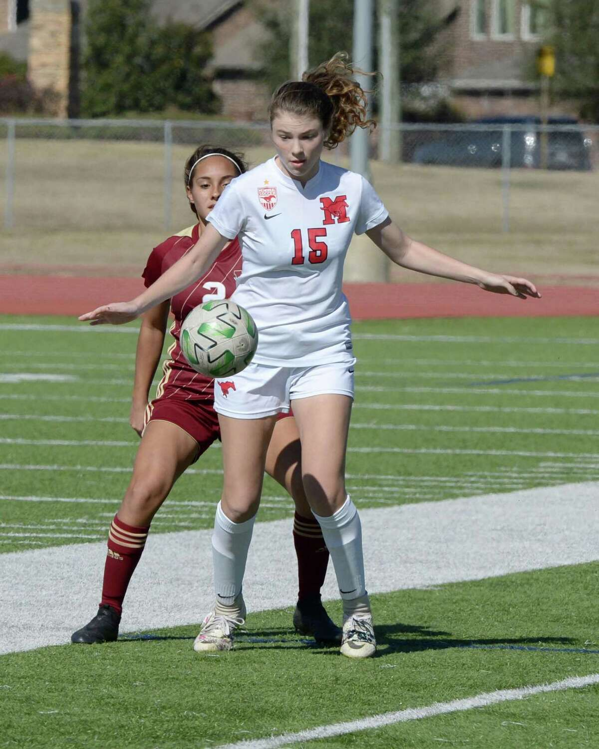 Zoe Seeley (15) of Memorial traps a ball in the second half of the girls soccer game between the Memorial Mustangs and the Cy Woods Wildcats during the I-10 Shootout on Thursday, January 14, 2021 at Tompkins High School, Katy, TX.