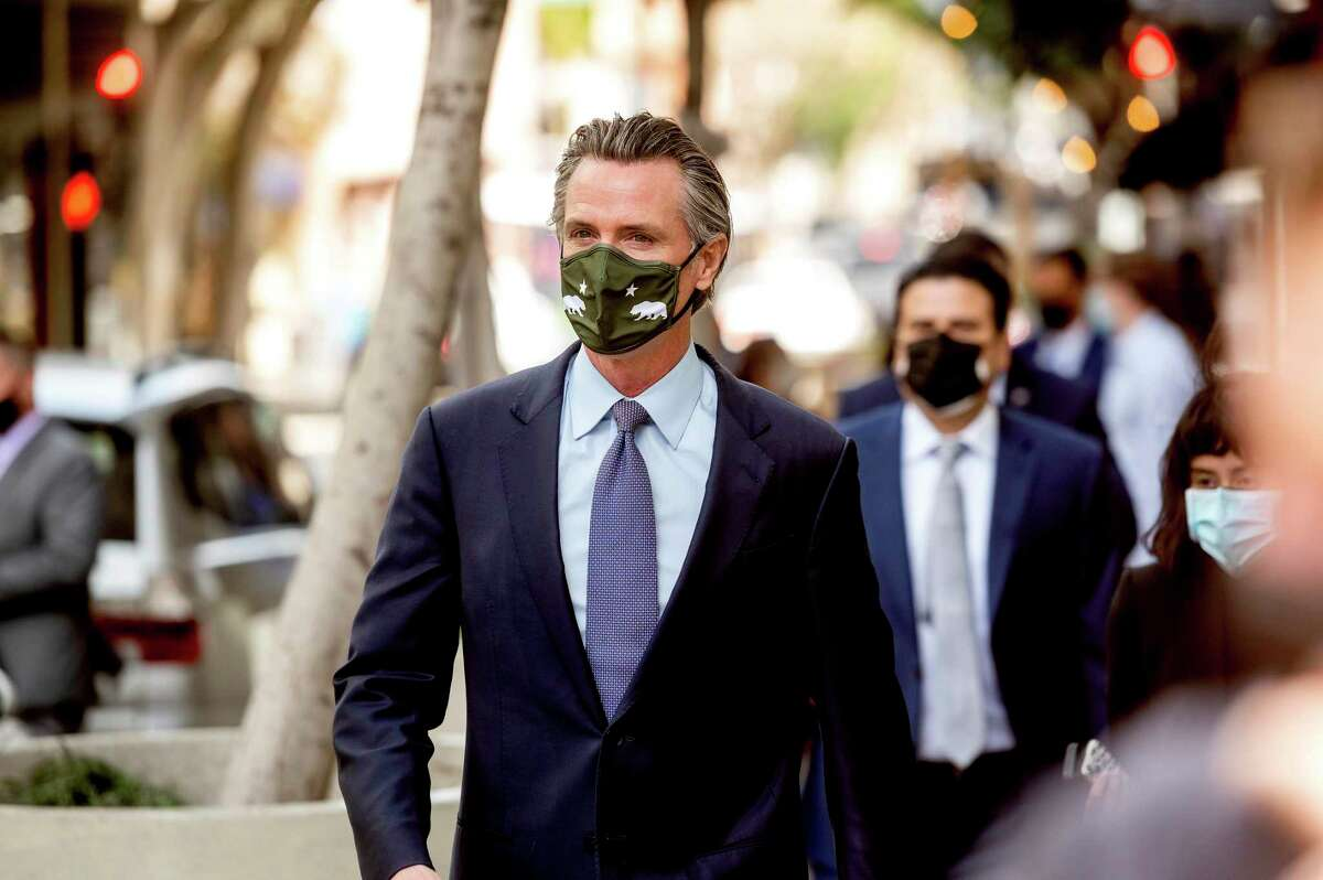 Gov. Gavin Newsom leaves a news conference in San Francisco Wednesday. A new poll indicates Newsom would prevail in a recall election if it were held today.